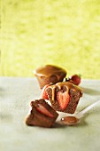 Small chocolate pudding with strawberry canter and toffee sauce