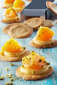 Breton shortbread cookies topped with confectionner's custard and peaches