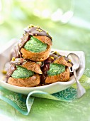 Pistachio ice cream Profiteroles with chocolate sauce