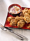 Nugget-style chicken wings in Tuc crust,onion sauce