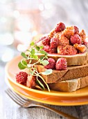 Roasted figs and caramelized raspberries on brioche toast