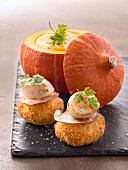 Fried breaded scallops with pumpkin sauce