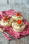 Cupcakes topped with a candied cherry