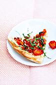 Slice of cherry tomato pizza