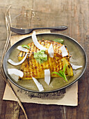 Grilled pineapple and coconut shavings