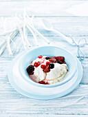 Yoghurt ice cream with fresh red fruits
