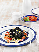Tagliolinis with squid ink and shrimps
