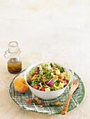 Varied salad with dried fruits, apricot vinaigrette