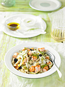 Pasta salad with salmon, cucumber, olives and dill