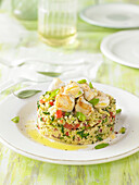 Timbale of semolina with vegetables and fish
