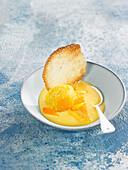 Cream and orange sorbet, sugar tile