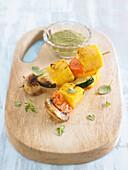 Skewers of polenta and vegetables with pesto sauce
