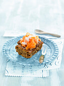 Cake with carrots and grated macadamia nuts
