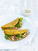Gluten-free pancakes stuffed with lentils, guacamole and tomatoes