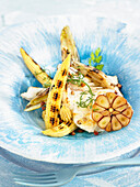 Monkfish braised with garlic, roasted baby corn and fennel