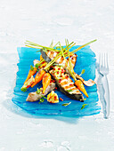 Braised salmon with young roasted carrots