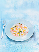 Shrimp carpaccio with green asparagus and yellow bell pepper