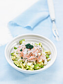 Tartar of scampi and avocado with colored fish eggs