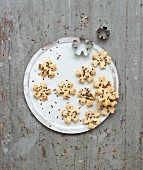 Parmesan and linseed flower-shaped biscuits