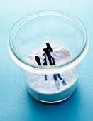 Pot of icing sugar and vanilla pods
