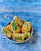 Small breaded and fried Kale cabbage croquettes