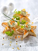 Herb cream cheese and salmon roe star toasts