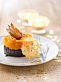 Blood sausage and pumpkin Parmentier with parmesan tuiles and roasted garlic