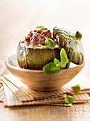 Round zucchini stuffed with lamb,pine nuts and mint