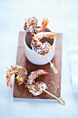 Prawns coated with a muesli and coconut flakes