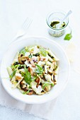 Pasta salad with penna, pesto, chicken and mushrooms