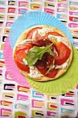 Thin tart with tomatoes, mozzarella and prosciutto
