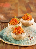Button mushroom tops garnished with quinoa