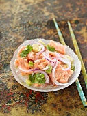 Salmon ceviche with red onions, coconut milk and lemon juice