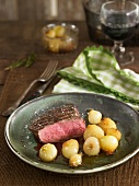 Beef fillet with small grelot onions