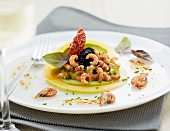 Melon and avocado carpaccio with brown prawns,guacamole,fish roe and confit tomatoes