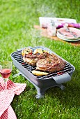 Grilling a beef chop on a barbecue outdoors
