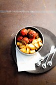 Meatball in tomato sauce with sauteed potatoes