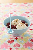 Almond milk ice cream with crushed almonds and preserved cherries