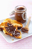 Toasted brioche with almond-flavored chocolate spread