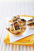 Simmered onions,black olives and anchovies on ciabatta bread