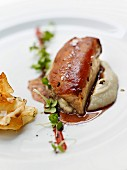 Suckling pig,mashed potatoes,Jerusalem artichoke chips and fresh daikon watercress