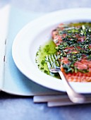 Fresh and raw salmon marinated with basil,dill and olive oil