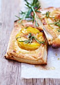 Peach,almond cream and rosemary tartlets