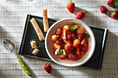 strawberry,melon and raspberry fruit salad with mint