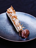 Almond meringue,hazelnut cream,Crêpe Dentelle and iced cocoa ganache