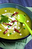 Minty cream of pea soup with diced bacon