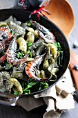 Pan-fried squid ink lasagnelles with spinach and shrimps