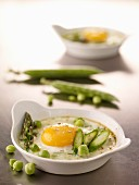 Coodled eggs with green asparagus and peas