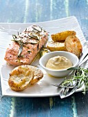 Salmon fillet with thyme and rosemary,roasted potatoes and mayonnaise