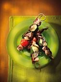 Veal rump, onion, tomato, zucchini and sage brochettes a la plancha